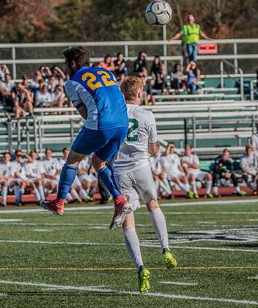 Tommy Pereira and Joey Carbone jumping to headbutt the ball