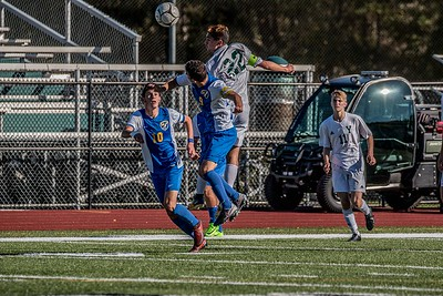 Max Litchman and Ankit Patel jumping to headbutt the ball