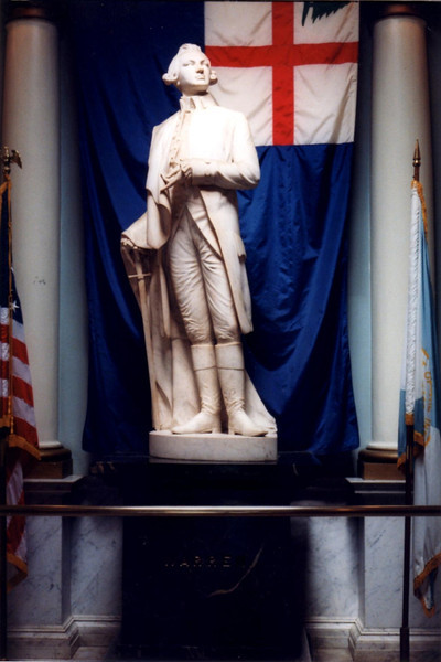 Statue of Warren in the building adjacent to the base of the Bunker Hill Monument