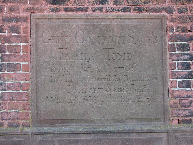 The upper plaque on the crypt