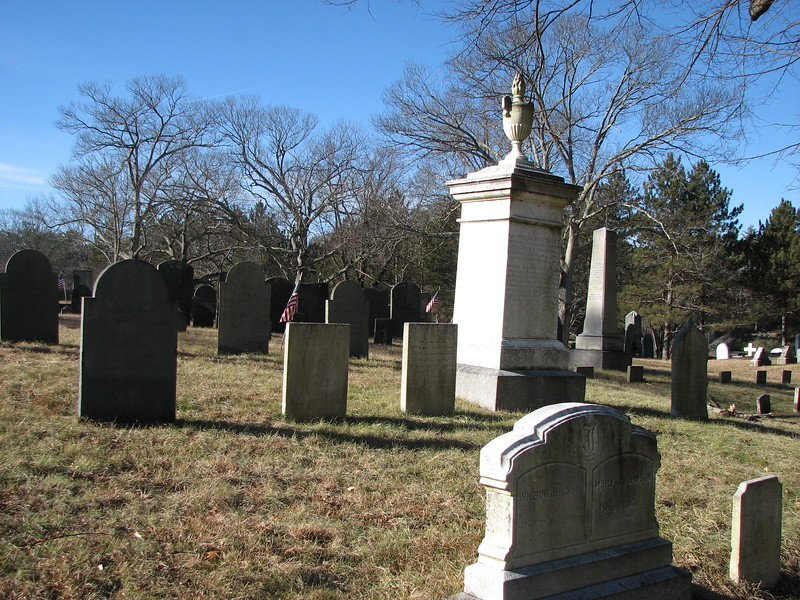 The Prentiss family plot, with the grave of Mercy Scollay at the left in this photo, three stones to the left of the large white monument to her sister and brother-in-law (Rev. Thomas and Mary Scollay Prentiss.) To locate this plot, enter the cemetery from the gate on Main St closest to Causeway St. Drive straight in passing the first road on the left and going about halfway to the next left. Look for the Prentiss monument two rows from the road, on your left.