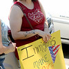 Jonathan Tressler - The News-Herald <br>  One of hundreds of demonstrators who gathered July 27 in Downtown Painesville to support a Painesville Latina facing deportation following a July 23 traffic stop.