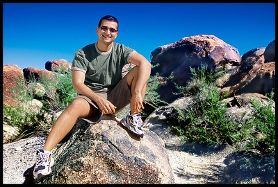 Nima poses at my favorite secluded camping spot in the Joshua Tree National Park.  Very few can find this place because it requires a four wheel drive and a GPS.  This spot makes a natural shelter being surrounded on all sides by large boulders.