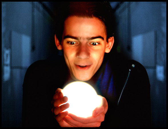 """Daniel N.  is a visual effects artist working on feature films.  He is a comedian at heart.  Here, he poses with a glowing ball used in the making of the Adam Sandler movie """"Little Nicky"""""""