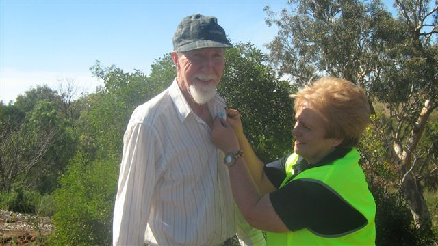 John Smith being presented with his volunteer badge