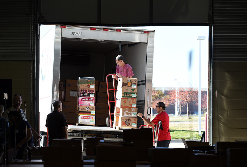 David Baak places boxes on a lift on the moving truck as volunteers, left, and chair person Gary Rozum, right, stand by while unloading books Wednesday, Oct. 25, 2017, in preparation of the Friends of the Loveland Public Library Used Book Sale this weekend at The Ranch in Loveland.   (Photo by Jenny Sparks/Loveland Reporter-Herald)