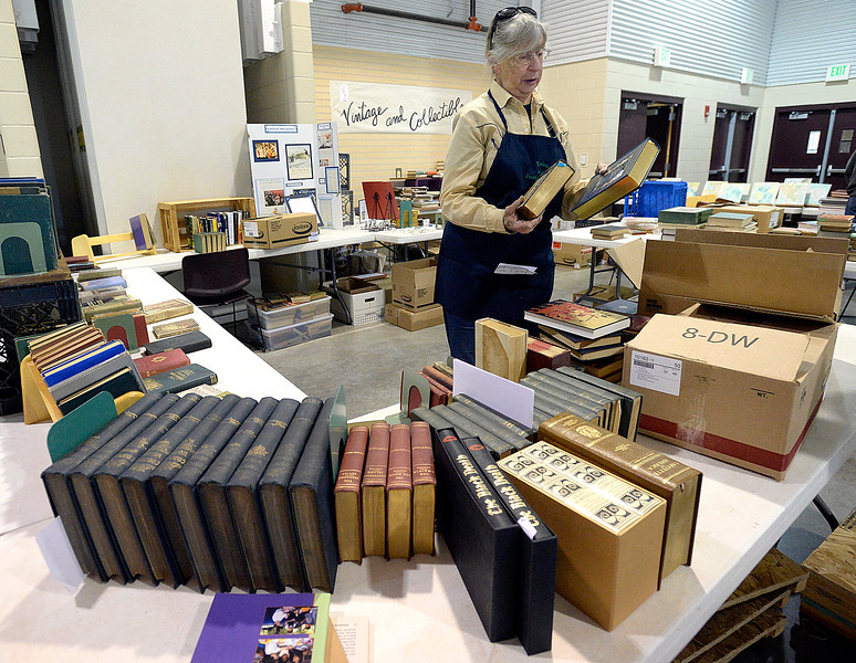 Volunteer Ruth McPherson unpacks and sets up books in the Vintage and Collectible section Wednesday, Oct. 25, 2017, in preparation of the Friends of the Loveland Public Library Used Book Sale this weekend at The Ranch in Loveland.   (Photo by Jenny Sparks/Loveland Reporter-Herald)
