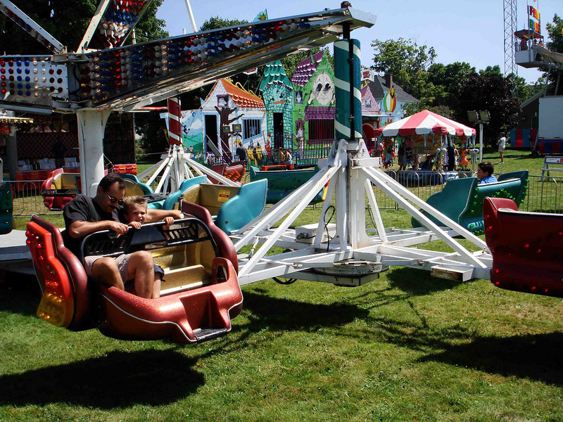 THE SCRAMBLER<br /> I'm not sure if that's what they're called now, but I do remember that this was my first experience with a carnival ride, back when I was a youngster. They had rides in the Wyatt Food Store's parking lot in Grand Prairie and I was put on one of these things by myself. My sister Lyn said my mouth was wide open and my hair stood on end the whole time. Little wonder. I don't think it was from fright, though, as that really kind of started my whole daredevil thing. The bigger and scarier the ride, the better I like it.