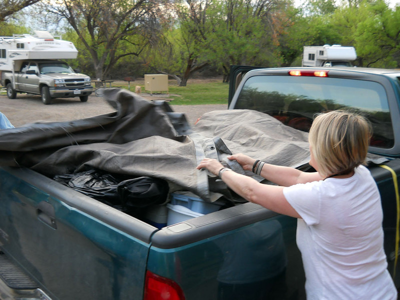 TARPS A-FLYIN'<br /> And here we are on Sunday morning, with Mev helping to tarp up Wayne's truck.