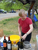MARY AT WORK<br /> Mary gets the eggs ready. No, we didn't have wine for breakfast. The bottles were just tabletop dressing at this point. The short, squat bottle is the Sotol I brought, which is a Tequila-type drink.