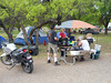 CAMPSITE 98<br /> A general overall shot of the campsite, showing the three blue tents and Mary's new BMW motorcycle.