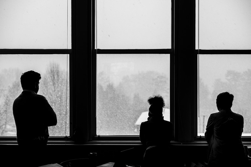 Watching snow falling as morning bell rings.  If the snow had come two hours earlier, school would've been cancelled, but it fell right at the start of school.
