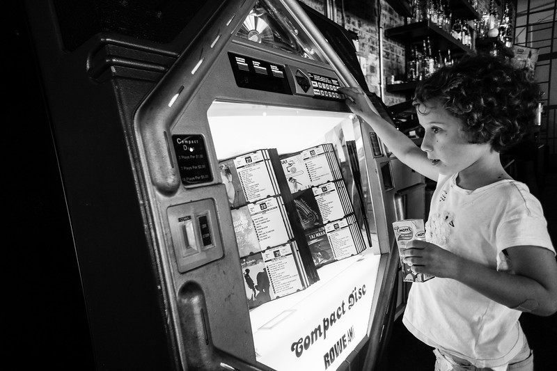 Our youngest, just hanging out at the jukebox with her juice box.