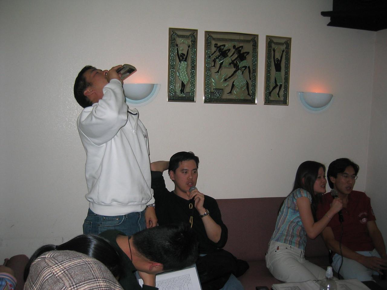 2004 12 18 Saturday - Alex Wang bottoms up @ karaoke