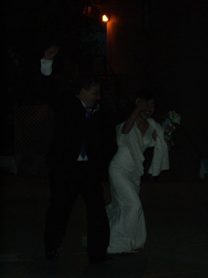 2006 05 06 Sat - Bride & Groom running off 1