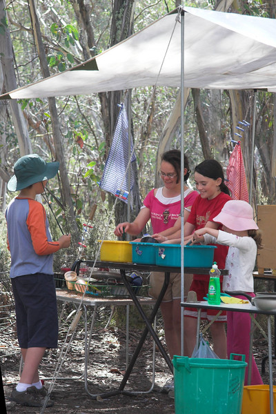 Madison, Bethany and Grace wash up whilst James supervises.
