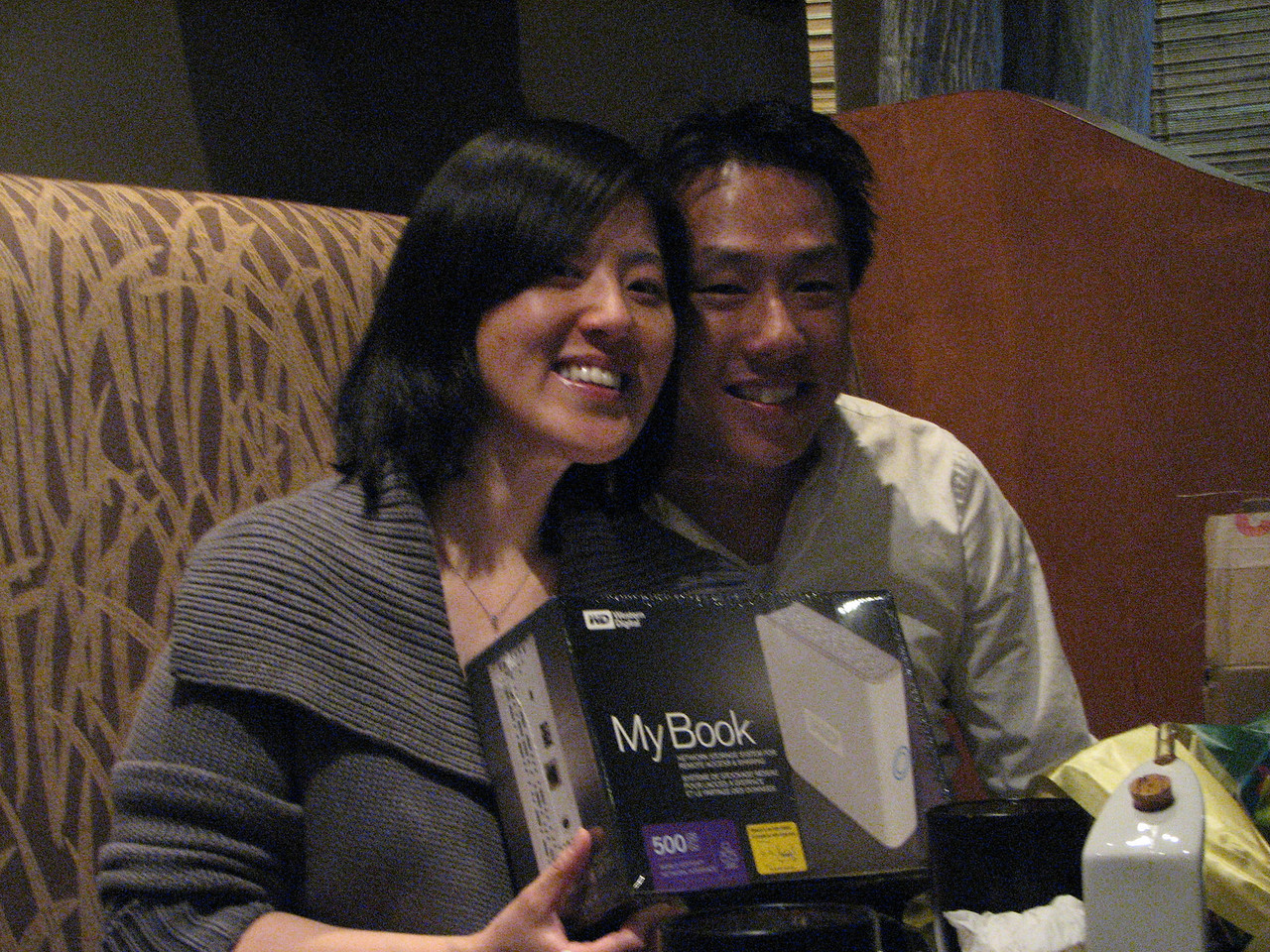 2008 03 15 Sat - Toros - Sojin Kim & Larry Lee opening presents
