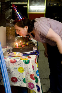Mindy blows out her candles