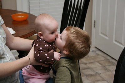 Garrett giving Addie some kisses.
