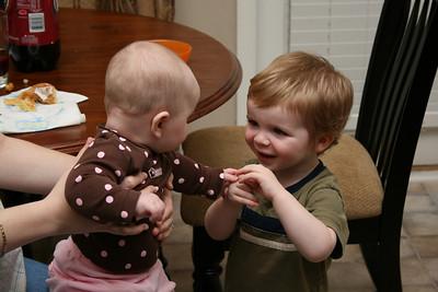 Addie and Garrett holding hands.