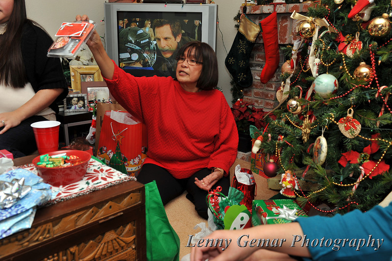 Aloma hands-out presents from under the tree.