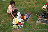 Claire straightens up Kyrstin's grave