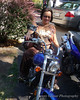Mamma Claire on a bike.  Where's her helmet?