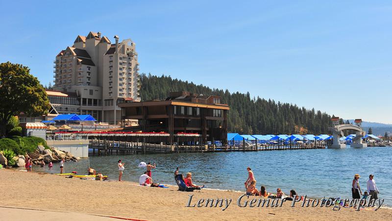 Fun seekers swimming and sunbathing near the Coeur d'Alene Resort.