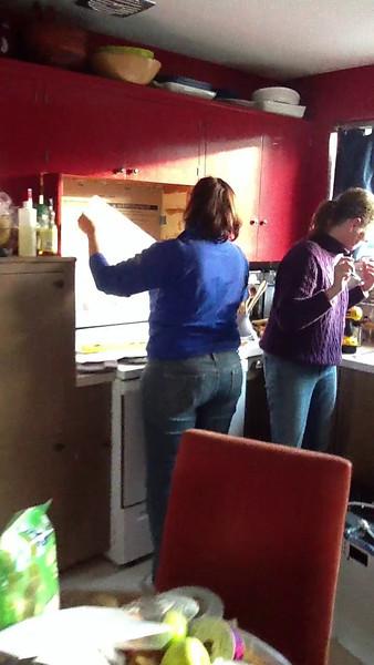 20111225 Kat hangs a new microwave
