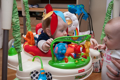 Andersen showing Savannah his Jumperoo.