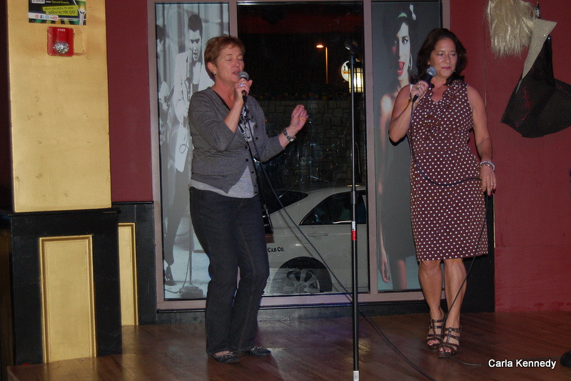 "Pam and Lisa singing ""Like a Virgin"""