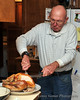 Quint carves the turkey