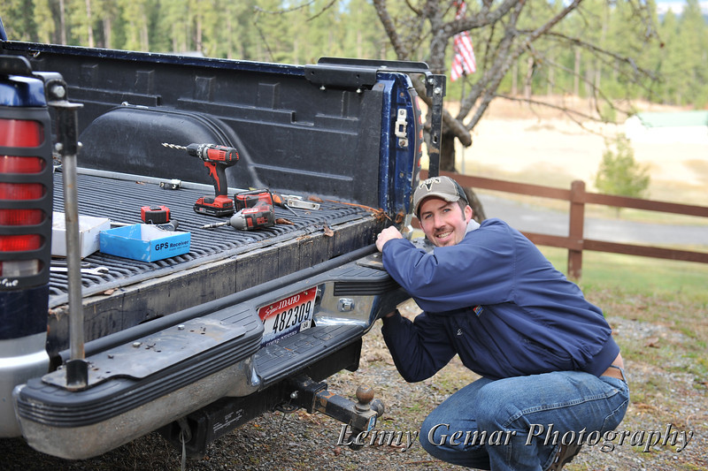 Dan works on Quint's truck installing a sand spreader.