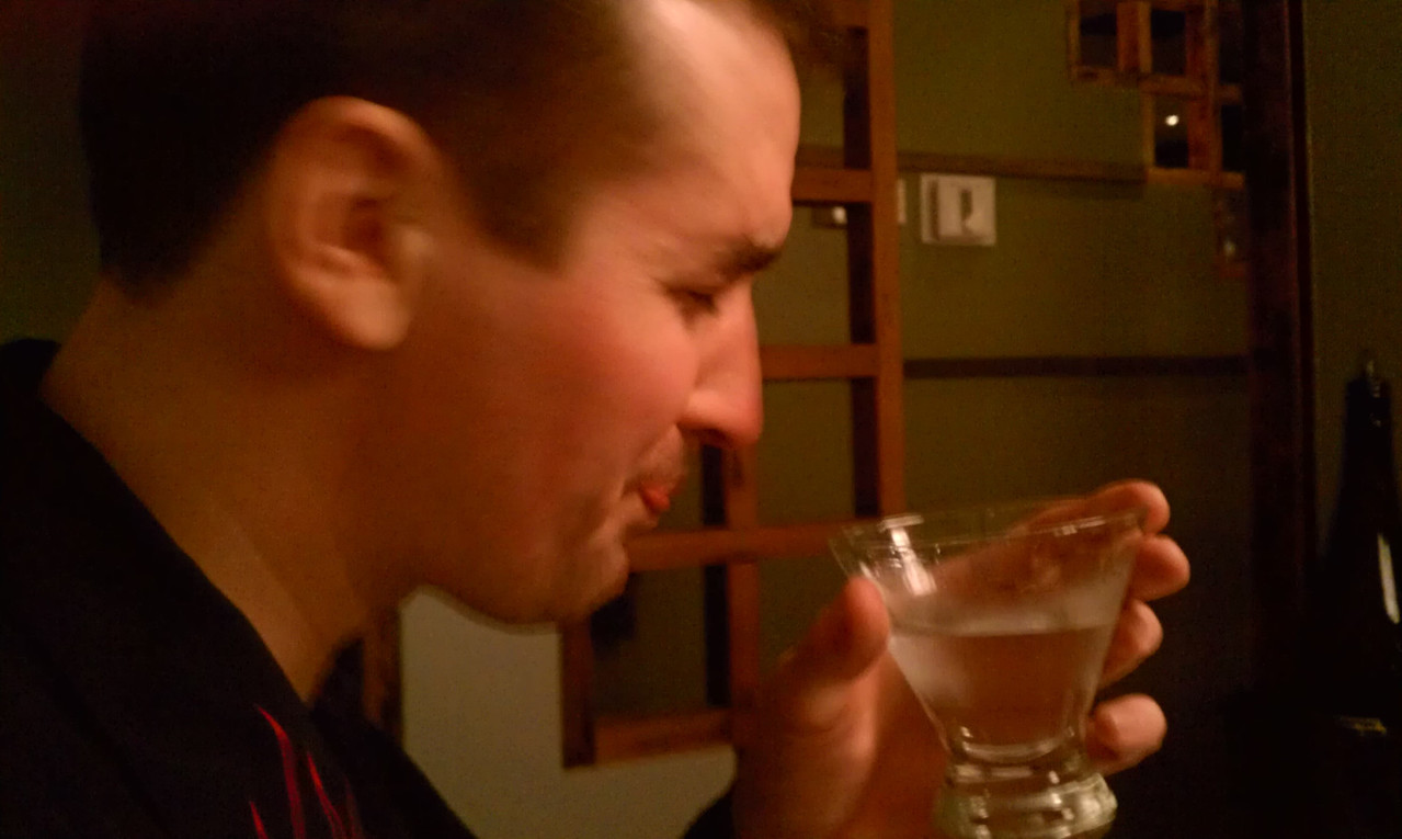his fav appletini....and flame shirt....just prior to throwing sushi at Guryn / Kahn across from him and hitting the divider between the two groups.