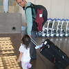 Arriving in Phoenix Airport--Leyna always wants to help with the bags.