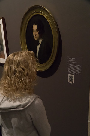 Stacey looks at a painting of the young O'Keeffe.