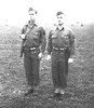 With the Distinguished Service Crosses on their chests, Staff Sergeant Beamish (left) and 2d Lt. George S. Spohn stand at attention.  Probably taken shortly after the award was made in 1944.