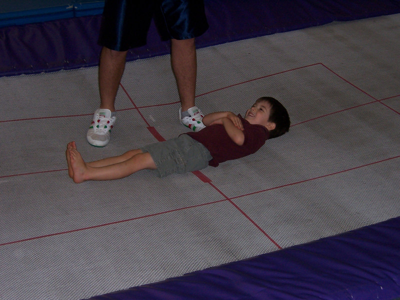 Aaron learning to bounce on the trampoline.