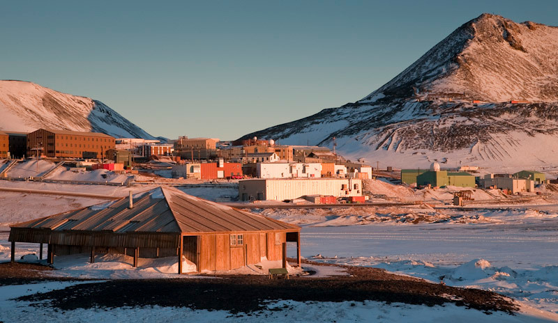Scott's hut with McMurdo station in the background.