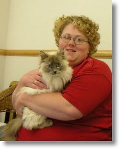 """Queene got a home and a family,  6-14-04<br /> Queenie is a beautiful Blue/Tortie Point Ragdoll that has provided Mason County with plenty of the Wal-Mart parking lot kitten """"give-a-ways"""" to last her a lifetime. Unfortunately, MANY of the cats and kittens were left behind when the owners moved out, not leaving any provisions (food, water, and shelter) for the kitties. This beauty was rail thin and pregnant. Fortunately, her kittens were aborted, and the veterinarian said she would have died if she had lived long enough to give birth. Queenie is sweet girl that has so many exceptional qualities, if you give her a loving home she'll be sure to treat you like royalty."""