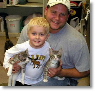 Johnny and Malone got adopted tonight 6/14/04.  Pictures of them with their new guardians