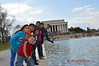 by the reflection pool near the Lincoln Memorial