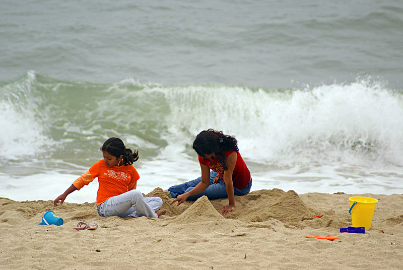 Sumana and Sailaja building sand castles..