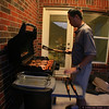 Oscar the grillmaster heating food up for Round 2 of eating.