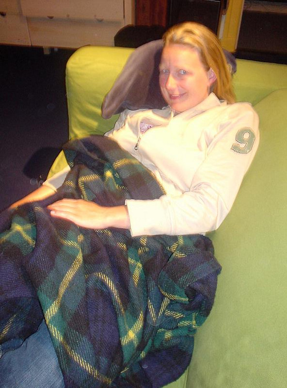 Femke all curled up on the couch, getting really comfy and sleepy