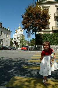 The christening of Christa-Reya took place in the Russian Orthodox church in Geneva. Octavia posing with present.