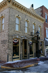 Wine store on ground floor with unique shops on second floor. Liz was so intrigued by the brick floor upstairs, she pulled up a brick to see how it was installed. Frank's bar and restaurant located in the lower level.