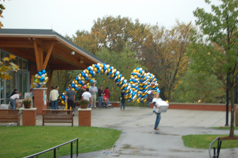 A balloon snake heads from the student center to the bridge on its way to the football field.