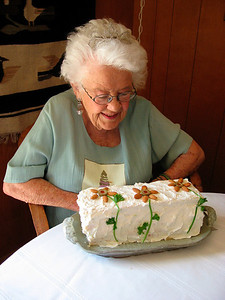 Jean admiring the frosted sandwich loaf made by Melanie. She really likes the flowers (olives, almonds and persley)