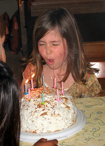 Ella blowing the candles